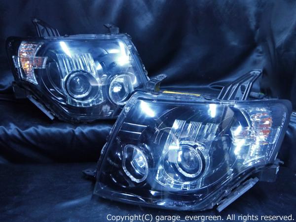 ミツビシ パジェロ 純正HID車用 ショート/ロング共通 純正ドレスアップヘッドライト 4連LEDイカリング&超高輝度白色LED増設&インナーブラッククロム